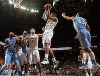 Virginia forward Akil Mitchell (25) grabs a rebound during an NCAA basketball game against Virginia Monday Jan. 20, 2014 in Charlottesville, VA. Virginia defeated North Carolina 76-61.