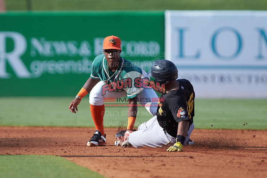 Greensboro Grasshoppers shortstop Osiris Johnson (1) applies a tag to Raul Hernandez (36) of the West Virginia Power as he slides into second base at First National Bank Field on August 9, 2018 in Greensboro, North Carolina. The Power defeated the Grasshoppers 5-3 in game one of a double-header. (Brian Westerholt/Four Seam Images)