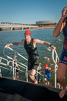 Seth O'Brien exits the water in the Lifetime Triathalon at Tempe Town Lake, is an amputee who competes in triathalons and works a prostheticist fabricating new limbs for clients.