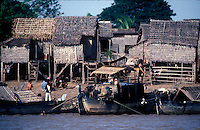 Boats dock along shore line of Vietnamese village in the southern Delta region.