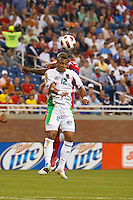 Guadeloupe midfielder Thomas Gamiette (12) heads the ball during the CONCACAF soccer match between Panama and Guadeloupe at Ford Field Detroit, Michigan.