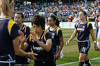 Aya Miyama (8) of the Los Angeles Sol slaps hands with teammate Allison Falk (3) as the teams enter the field. The Los Angeles Sol defeated Sky Blue FC 2-0 during a Women's Professional Soccer match at TD Bank Ballpark in Bridgewater, NJ, on April 5, 2009. Photo by Howard C. Smith/isiphotos.com