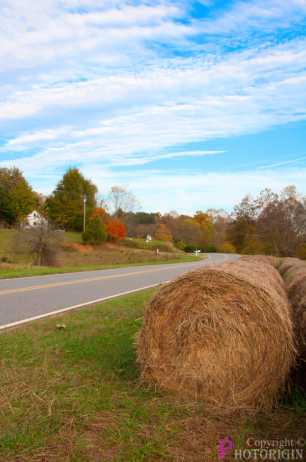 Hay Rolls On RoadSide of Brushy Mountain with partial cloudy sky addng beauty to the picture.