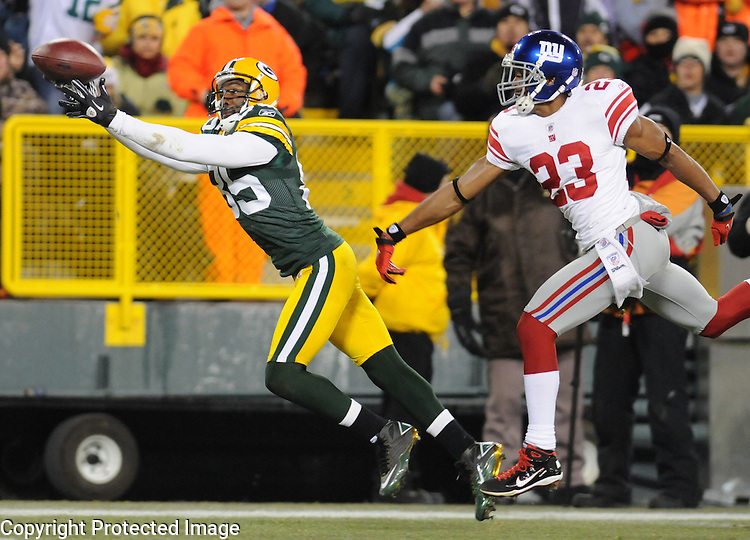 Green Bay Packers receiver Greg Jennings makes a first down catch to the one-yard-line ahead of New York Giants' Corey Webster during the third quarter of the game at Lambeau Field in Green Bay, Wis., on Dec. 26, 2010.