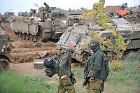 Israeli soldiers near their tanks and armoured vehicles, on the Israel-Gaza border. Israeli forces began an air offensive against Hamas in Gaza on 27/12/2008, which quickly escalated into an offensive by land, sea and air, in retaliation against Palestinian rockets fired into Israel. After eight days of bombardment, leaving over 400 Palestinians and four Israelis dead, Israeli tanks entered Gaza on 04/01/2009...