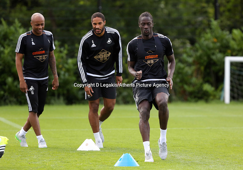 Thursday 09 July 2015<br /> Pictured L-R: Andre Ayew, Ashley Williams and Eder <br /> Re: Swansea City FC pre-season training at Landore training ground, Swansea, south Wales, UK.