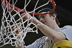SALEM, VA - MARCH 17: Nebraska Wesleyan Prairie Wolves guard Austin Hall (11) cuts down the net after the Prairie Wolves win their first Division III Men's Basketball Championship held at the Salem Civic Center on March 17, 2018 in Salem, Virginia. Nebraska Wesleyen defeated Wisconsin-Oshkosh 78-72 for the national title. (Photo by Andres Alonso/NCAA Photos/NCAA Photos via Getty Images)