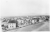 Roof-top view of Monte Vista in 1885.  A sign for H. H. Marsh adorns one building and a real estate building is at right.<br /> Monte Vista, CO  1885