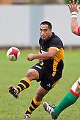 Joe Heta chips over the top of a Waiuku defender. Counties Manukau Premier Club Rugby game between Waiuku and Bombay, played at Waiuku on Saturday July 5th 2010. Waiuku won 59 - 14 after trailing 12 - 14 at halftme.