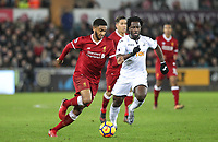 Joe Gomez of Liverpool moves past Wilfried Bony of Swansea City during the Premier League match between Swansea City and Liverpool at the Liberty Stadium, Swansea, Wales on 22 January 2018. Photo by Mark Hawkins / PRiME Media Images.