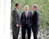 Washington, DC - October 6, 2009 -- United States House Republican Leader John Boehner (Republican of Ohio), left, U.S. Senator John McCain (Republican of Arizona), center, and U.S. Senate Republican Leader Mitch McConnell (Republican of Kentucky), right, share some thoughts before meeting reporters after meeting United States President Barack Obama on the U.S. strategy in Afghanistan on Tuesday, October 6, 2009..Credit: Ron Sachs / Pool via CNP