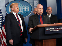 United States President Donald J. Trump listens to Arturo Del Cueto, National Spokesperson, National Border Patrol Council speak about border security in the White House briefing room in Washington, DC, January 3, 2019. Credit: Chris Kleponis / CNP/AdMedia