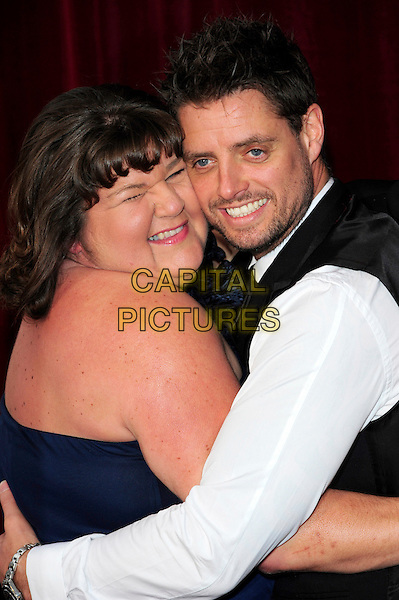 CHERYL FERGISON & KEITH DUFFY.British Soap Awards 2010 at the London ITV Studios, South Bank, London, England..May 8th 2010.arrivals half length white shirt strapless blue black hug embrace looking over shoulder facial hair smiling funny .CAP/CJ.©Chris Joseph/Capital Pictures.