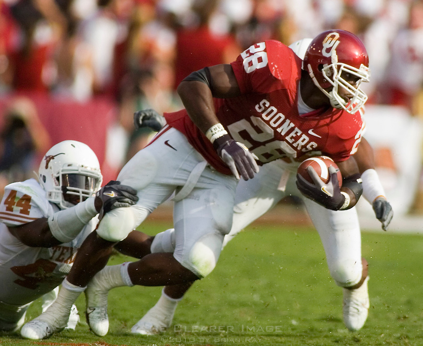 07 October 2006: University of Oklahoma back Adrian Peterson is tackled by Texas defenders Michael Griffin (#27) and Rashad Bobino (#44) during the Sooners 28-10 loss to the University of Texas Longhorns at the Cotton Bowl in Dallas, TX.