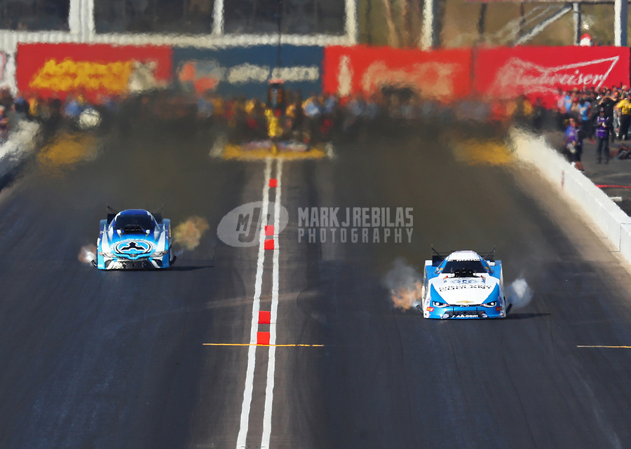 Feb 25, 2018; Chandler, AZ, USA; NHRA funny car driver John Force (right) races alongside Jonnie Lindberg during the Arizona Nationals at Wild Horse Pass Motorsports Park. Mandatory Credit: Mark J. Rebilas-USA TODAY Sports