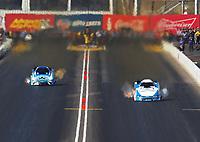 Feb 25, 2018; Chandler, AZ, USA; NHRA funny car driver John Force (right) races alongside Jonnie Lindberg during the Arizona Nationals at Wild Horse Pass Motorsports Park. Mandatory Credit: Mark J. Rebilas-USA TODAY Sports