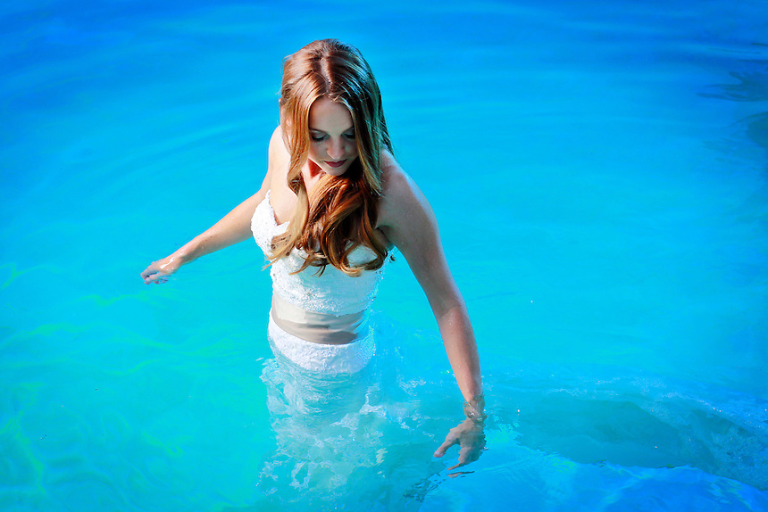 Photograph by K.C. Alfred c 2013 A female underwater fashion model.