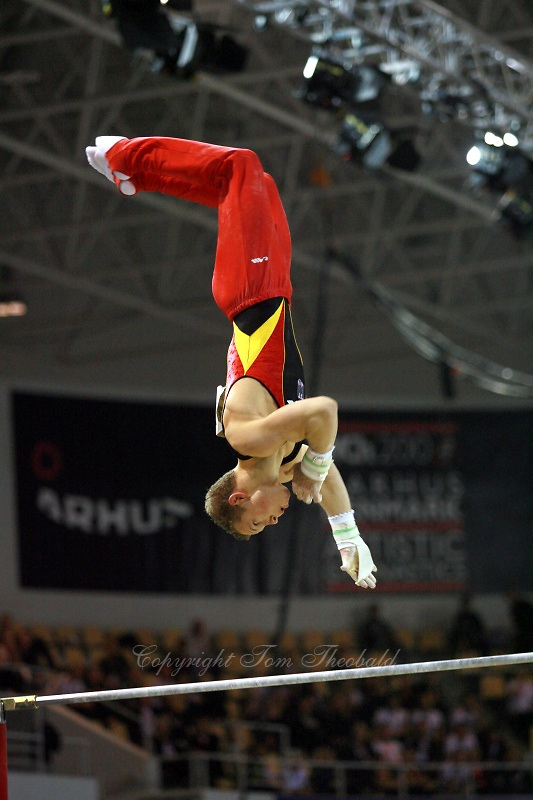 Oct 17, 2006; Aarhus, Denmark;  Fabian Hambuechen of Germany performs on high bar during men's gymnastics team final competition at 2006 World Championships Artistic Gymnastics.