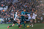 Cristiano Ronaldo of Real Madrid (C) fights for the ball with Martin Montoya Torralbo of Valencia CF (R) and Antonio Latorre Grueso, Lato, of Valencia CF (L) during the La Liga 2017-18 match between Valencia CF and Real Madrid at Estadio de Mestalla  on 27 January 2018 in Valencia, Spain. Photo by Maria Jose Segovia Carmona / Power Sport Images