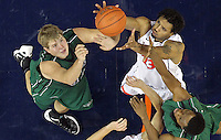 CHARLOTTESVILLE, VA- NOVEMBER 26:  Mike Scott #23 of the Virginia Cavaliers reaches for the rebound with Brennan Cougill #44 of the Green Bay Phoenix during the game on November 26, 2011 at the John Paul Jones Arena in Charlottesville, Virginia. Virginia defeated Green Bay 68-42. (Photo by Andrew Shurtleff/Getty Images) *** Local Caption *** Mike Scott;Brennan Cougill