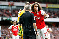 Referee, Jonathan Moss oversees with Thomas Heaton of Aston Villa and Mattéo Guendouzi of Arsenal during the Premier League match between Arsenal and Aston Villa at the Emirates Stadium, London, England on 22 September 2019. Photo by Carlton Myrie / PRiME Media Images.
