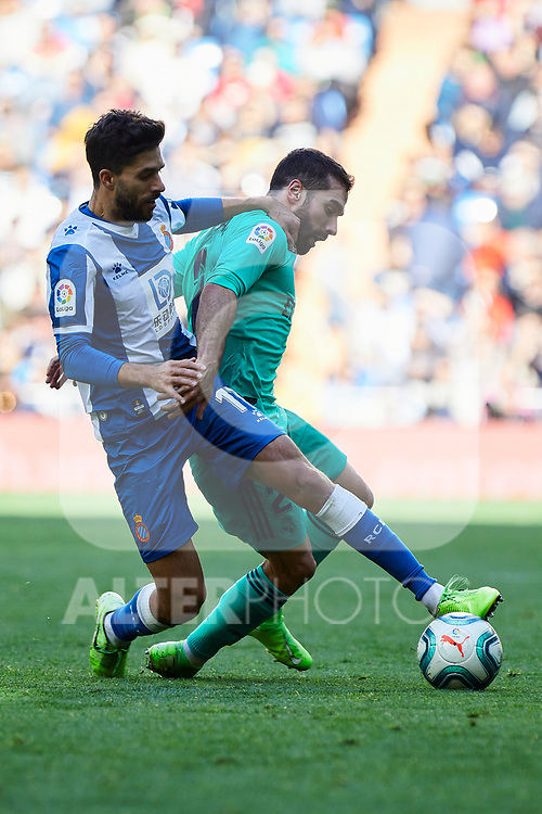 Dani Carvajal of Real Madrid and Dídac Vila of RCD Espanyol fight for the ball during La Liga match between Real Madrid and RCD Espanyol at Santiago Bernabeu Stadium in Madrid, Spain. December 07, 2019. (ALTERPHOTOS/A. Perez Meca)