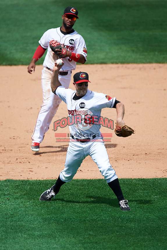 Rochester Red Wings third baseman Stephen Wickens (38) throws to first as Danny Santana (9) looks on during a game against the Columbus Clippers on June 16, 2016 at Frontier Field in Rochester, New York.  Rochester defeated Columbus 6-2.  (Mike Janes/Four Seam Images)
