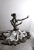 MAURITIUS, Surinam, a young woman Sega dancer, Cyndia Venratachullum, poses for a portrait in her home (B&W)
