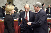 Federal Reserve Board Chairman Alan Greenspan, center, discusses his pending testimony with United States Senators Hillary Rodham Clinton (Democrat of New York), left, and Kit Bond (Republican of Missouri), right, before the U.S. Senate Budget Committee meeting on 25 January, 2001 in Washington, DC.<br /> Credit: Ron Sachs / CNP