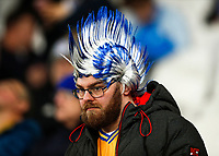 28th December 2019; London Stadium, London, England; English Premier League Football, West Ham United versus Leicester City; Leicester City fan in fancy head piece watches on from the away stands while wearing a custom Leicester City mohawk hat - Strictly Editorial Use Only. No use with unauthorized audio, video, data, fixture lists, club/league logos or 'live' services. Online in-match use limited to 120 images, no video emulation. No use in betting, games or single club/league/player publications