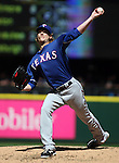 Texas Rangers' starter Ross Detwiler pitches agains the Seattle Mariners at SAFECO Field in Seattle on April 10, 2015.  The Mariners came from behind to beat the Rangers 11-10.  Jim Bryant Photo. ©2015. All Rights Reserved.