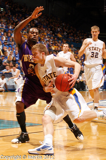 SIOUX FALLS, SD - MARCH 6:  Nate Wolters #3 from South Dakota State University drives against Tommie Tyler #3 from Western Illinois University in the first half during the 2012 Summit League Championship game Tuesday night at the Sioux Falls Arena. (Photo by Dave Eggen/Inertia)