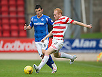 St Johnstone v Hamilton Accies...12.09.15  SPFL McDiarmid Park, Perth<br /> Ziggy Gordon tackles Graham Cummins<br /> Picture by Graeme Hart.<br /> Copyright Perthshire Picture Agency<br /> Tel: 01738 623350  Mobile: 07990 594431
