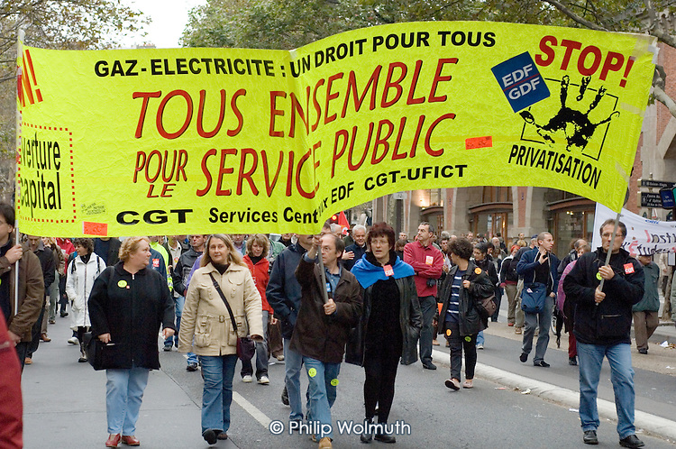 Electricity and gas industry workers join a mass demonstration in Paris against a new work contract, introduced by Prime Minister Dominique de Villepin, that allows companies with fewer than 20 employees to fire them within two years instead of six months.