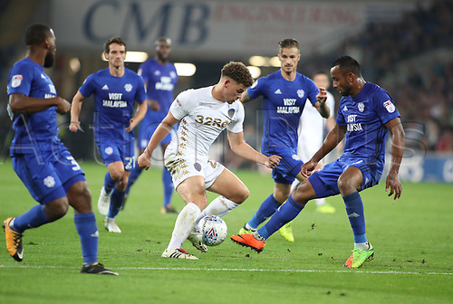 26th September 2017, Cardiff City Stadium, Cardiff, Wales; EFL Championship football, Cardiff City versus Leeds United; Kalvin Phillips of Leeds United attempts to break into Cardiff City's box but gets stopped by Loic Damour of Cardiff City