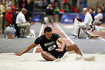 NAPERVILLE, IL - MARCH 11: Ta'riq Thomas of Delaware Valley University lands in the sand pit during the men's triple jump at the Division III Men's and Women's Indoor Track and Field Championship held at the Res/Rec Center on the North Central College campus on March 11, 2017 in Naperville, Illinois. (Photo by Steve Woltmann/NCAA Photos via Getty Images)