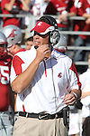 Paul Wulff, Washington State head football coach, talks with his staff in the booth during the Cougars 23-22 comeback victory over Montana State at Martin Stadium on the WSU campus on September 11, 2010.