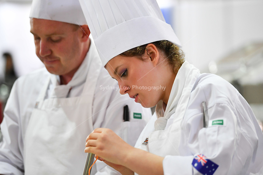 Melbourne, 30 May 2017 - Laura Skvor commis chef assisting Michael Cole of the Georgie Bass Cafe & Cookery in Flinders prepares a garnish at the Australian selection trials of the Bocuse d'Or culinary competition held during the Food Service Australia show at the Royal Exhibition Building in Melbourne, Australia. Photo Sydney Low