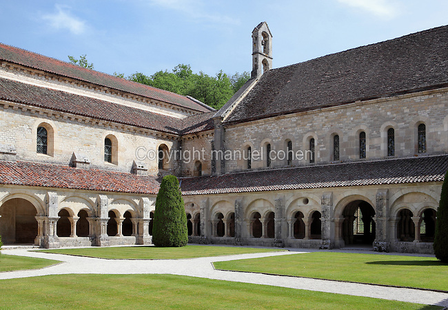 Romanesque cloister, Fontenay Abbey, Marmagne, Cote d'Or, France. This Cistercian abbey was founded by Saint Bernard of Clairvaux in 1119, built in the Romanesque style. The abbey itself housed 300 monks from 1200, but was sacked during the French Revolution. The 36m cloister dates from the 12th century and the monks would have spent their free time here. The arcade is divided by pillars into small galleries. Picture by Manuel Cohen