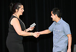 Western Nevada College Adult Literacy & Language program coordinator Angela Holt congratulates scholarship winner Felipe Macias during a ceremony as more than 100 students received their High School Equivalency during a Western Nevada College ceremony in Carson City, Nev., on Monday, June 19, 2017. <br /> Photo by Cathleen Allison/Nevada Photo Source