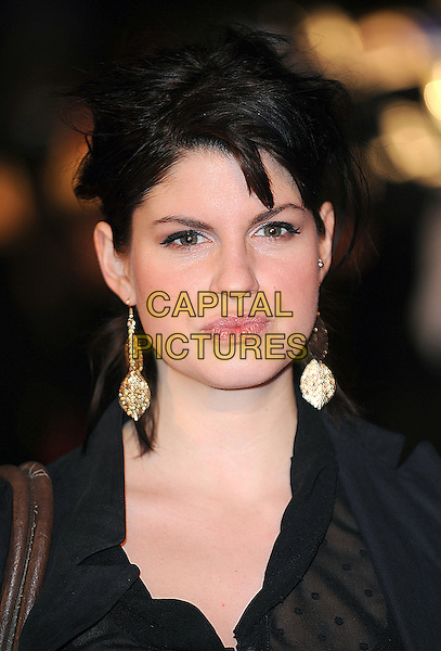 "JEMIMA ROOPER.UK Premiere of ""Confessions of a Shopaholic"" at the Empire Cinema, Leicester Square, London, England..February 16th 2009 .portrait headshot black gold dangling earrings .CAP/BEL.©Tom Belcher/Capital Pictures."