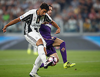 Calcio, Serie A: Juventus vs Fiorentina. Torino, Juventus Stadium, 20 agosto 2016.<br /> Juventus&rsquo; Sami Khedira, left, is challenged by Fiorentina&rsquo;s Gonzalo Rodriguez during the Italian Serie A football match between Juventus and Fiorentina at Turin's Juventus Stadium, 20 August 2016. Juventus won 2-1.<br /> UPDATE IMAGES PRESS/Isabella Bonotto