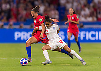 LYON,  - JULY 2: Carli Lloyd #10 is fouled by Demi Stokes #12 during a game between England and USWNT at Stade de Lyon on July 2, 2019 in Lyon, France.
