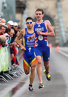 11 SEP 2010 - BUDAPEST, HUN - With a  spring in his step Alistair Brownlee keeps ahead of rival Javier Gomez on his way to victory at the 2010 Elite Mens ITU World Championship Series Triathlon final (PHOTO (C) NIGEL FARROW)