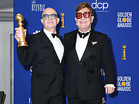 05 January 2020 - Beverly Hills, California - Bernie Taupin, Elton John. 77th Annual Golden Globes - Press Room held at Beverly Hilton Hotel. Photo Credit: Birdie Thompson/AdMedia