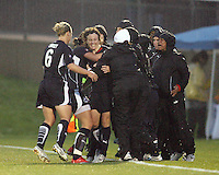 Sonia Bompastor #8 of the Washington Freedom is congratulated after scoring the tying goal during a WPS match against St. Louis Athletica at the Maryland Soccerplex on May 3, 2009 in Boyds Maryland. The game ended in a 3-3 tie.