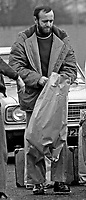 Tommy McKinney, a republican internee, Maze Prison, Lisburn, N Ireland, steps to freedom with his personal belongings in a paper sack after the ending of Internment on 5th December 1975. 197512050755TMK1..Copyright Image from Victor Patterson, 54 Dorchester Park, Belfast, UK, BT9 6RJ..Tel: +44 28 9066 1296.Mob: +44 7802 353836.Voicemail +44 20 8816 7153.Skype: victorpattersonbelfast.Email: victorpatterson@me.com.Email: victorpatterson@ireland.com (back-up)..IMPORTANT: If you wish to use this image or any other of my images please go to www.victorpatterson.com and click on the Terms & Conditions. Then contact me by email or phone with the reference number(s) of the image(s) concerned.