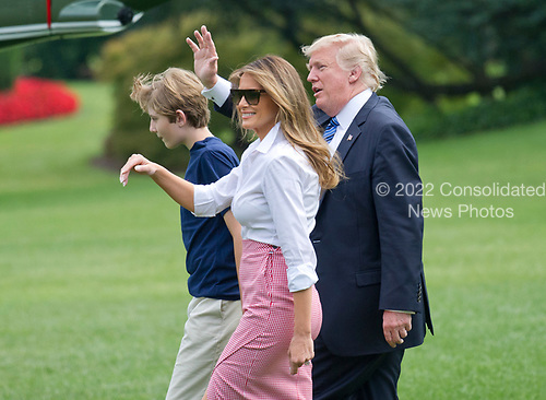 United States President Donald J. Trump and first lady Melania Trump wave to guests as they and son Barron depart the White House in Washington, DC for a weekend in Westminster, NJ on Friday, June 30, 2017. <br /> Credit: Ron Sachs / CNP
