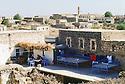 Turkey 1997 .Morning in Midin, a family having lunch on the terrace of their house.Turquie 1997.Un matin a Midin, village du Tour Abdin,une famille dejeune sur la terrasse de leur maison