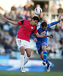 Getafe's Mehdi Lacen against Malaga's Jose Garcia Recio during La Liga Match. March 03, 2012. (ALTERPHOTOS/Alvaro Hernandez)
